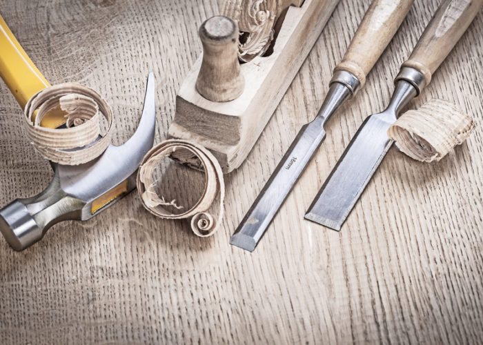vintage wooden planer and chissels with shavings.